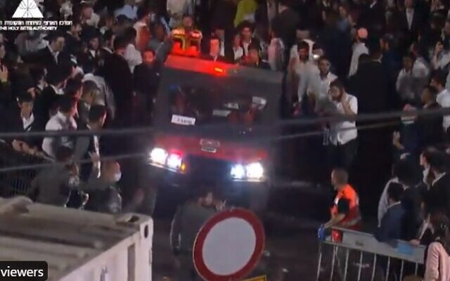 An ambulence tries to navigate through the crowd at Mount Meron in northern Israel on April 30, 2021 after a stand collapsed wounding dozends (Screencapture/Twitter)